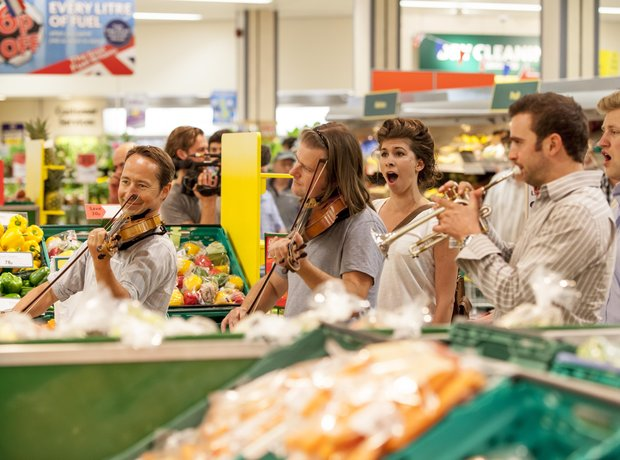 Flash Mob performing in the supermarket aisles