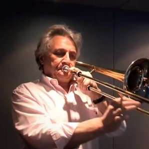 John Suchet playing the trombone