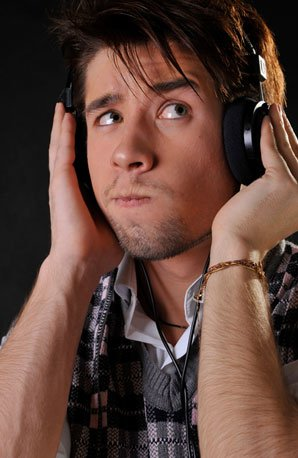 Puzzled music listener with headphones