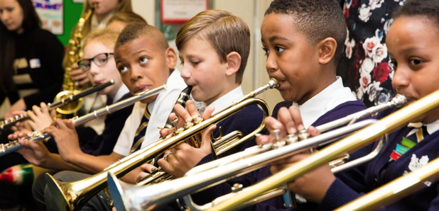 kids playing trumpets